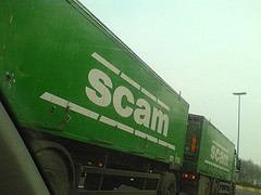"[truck with the word ""Scam"" on it]"